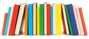 Long row of colorful library books isolated on white background